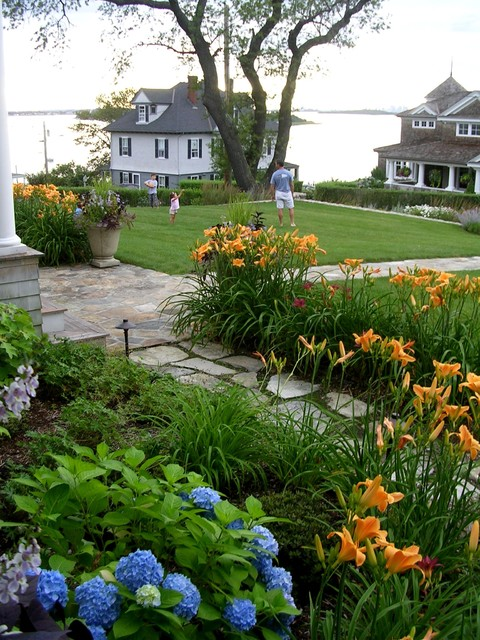 Inspiration for a large beach style front yard stone landscaping in Boston for summer.