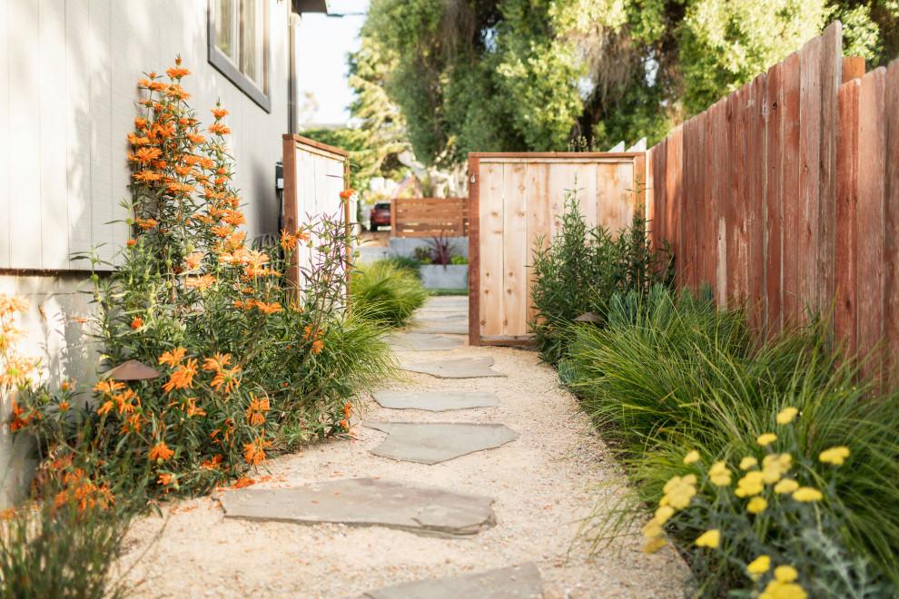 Inspiration for a coastal full sun side yard stone garden path in San Luis Obispo.