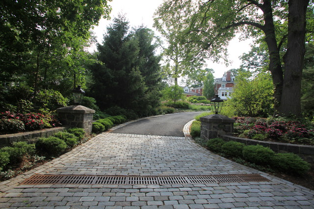 Cobblestone Entry With Stone Piers And Walls Traditional