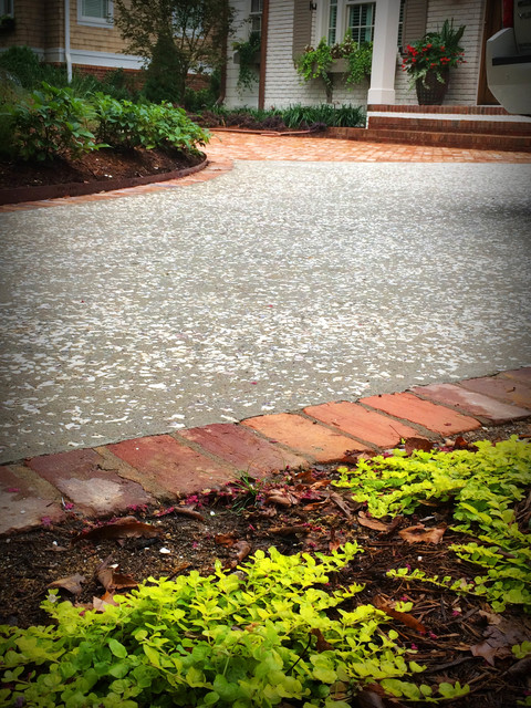 Concrete motor court seeded with oyster shell landscape for Crushed oyster shells for landscaping