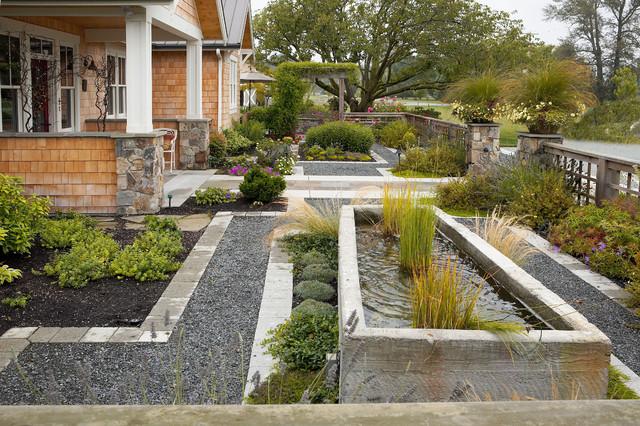 Concrete water trough fountain. farmhouse-landscape