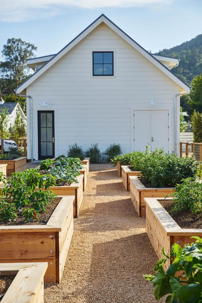 Inspiration for a large farmhouse full sun backyard gravel vegetable garden landscape in San Francisco for summer.