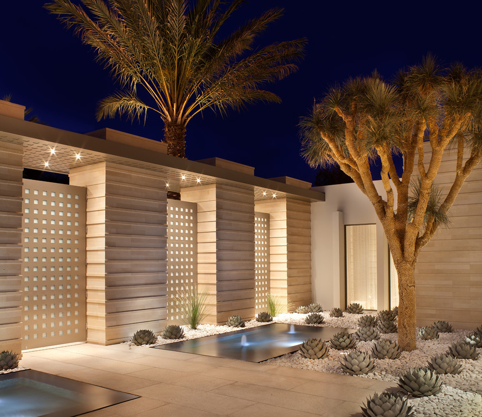 Inspiration for a small contemporary full sun and desert courtyard gravel landscaping in Los Angeles for summer.