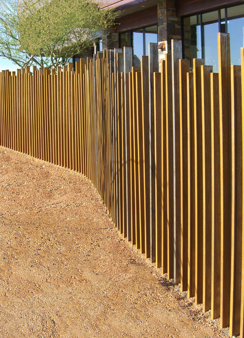 How to choose the right fence for your yard install it for Wood screen fence