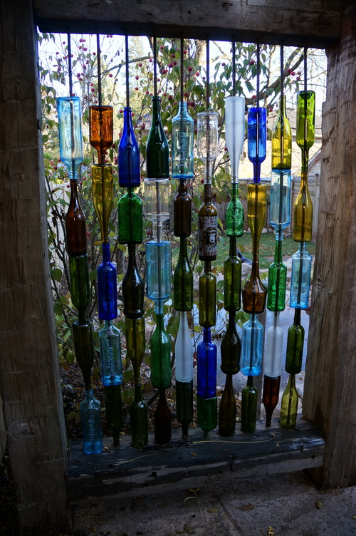 Here is an example that shows that privacy screens can really break the mold. This is a very creative idea using found materials. In this case, glass bottles were utilized. Using colored glass can make your space visually interesting when the sun breaks through and passes through the glass walls.
