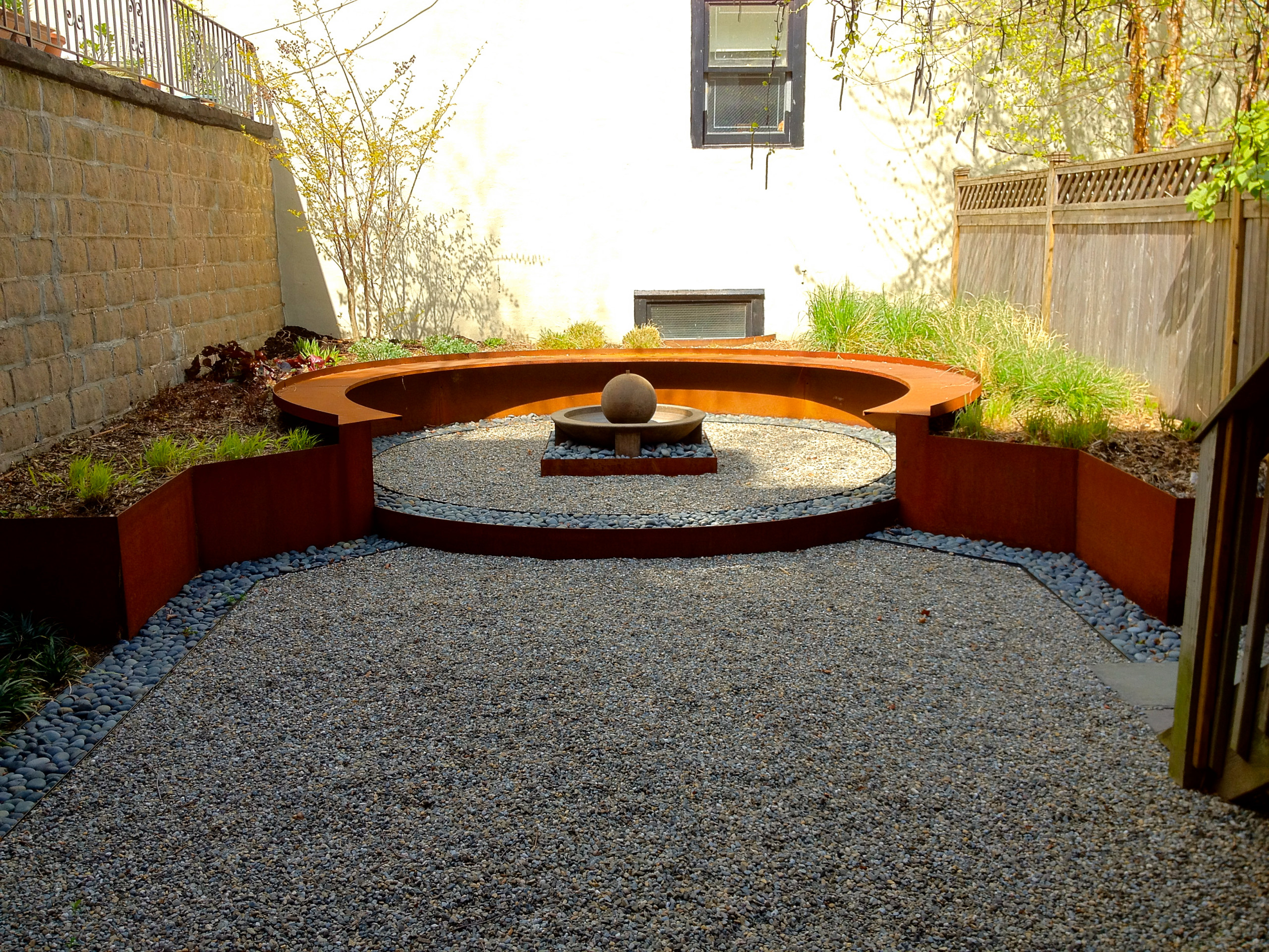 Corten planter with spring plantings