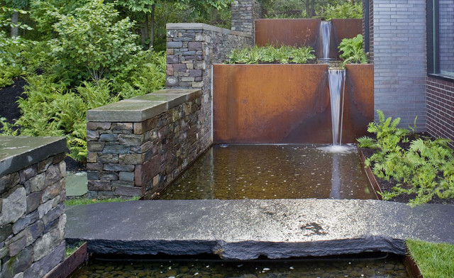 Corten steel waterfall industrial landscape for Garden renovation ideas