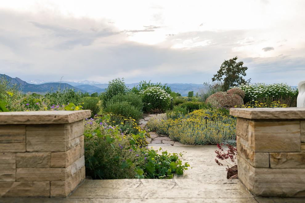 This is an example of a farmhouse stone garden path in Denver.