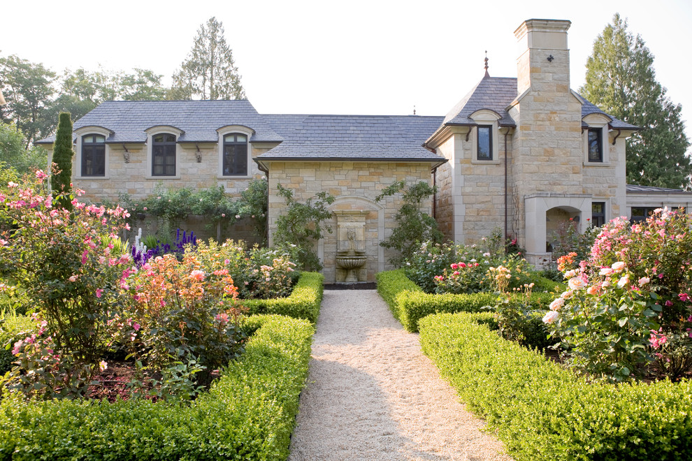 Inspiration for a large traditional gravel formal garden in Seattle.