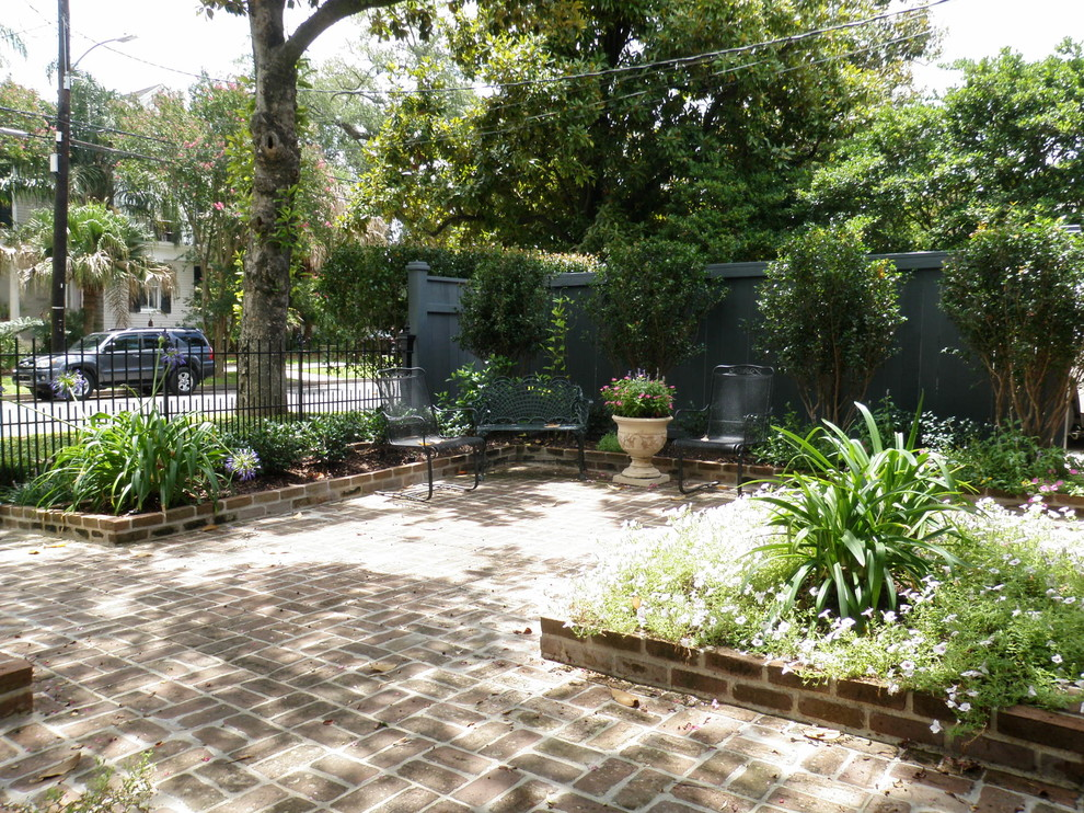 Design ideas for a mid-sized traditional partial sun courtyard brick outdoor sport court in New Orleans.