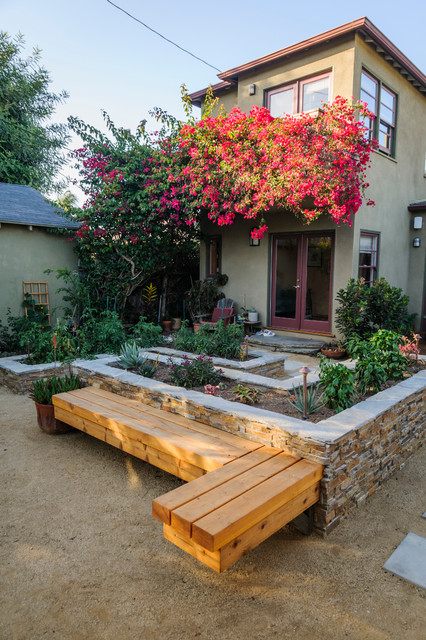 Design ideas for a medium sized traditional back formal partial sun garden for spring in Los Angeles with gravel and a vegetable patch.