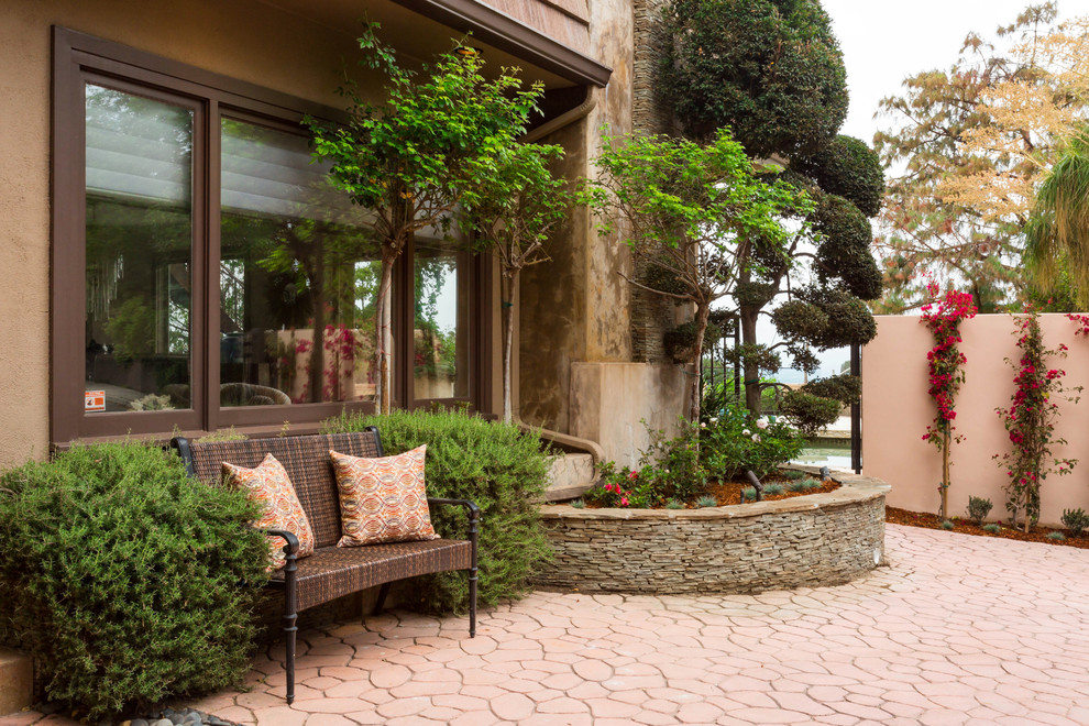 Design ideas for a large mediterranean full sun front yard concrete paver landscaping in Los Angeles.