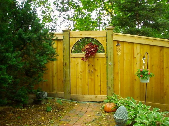 Custom Fence Project With Repurposed Floor Grate As Gate