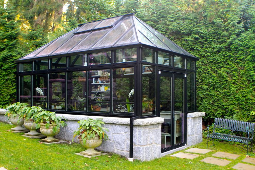 Design ideas for a large contemporary full sun backyard concrete paver formal garden in Vancouver for spring.