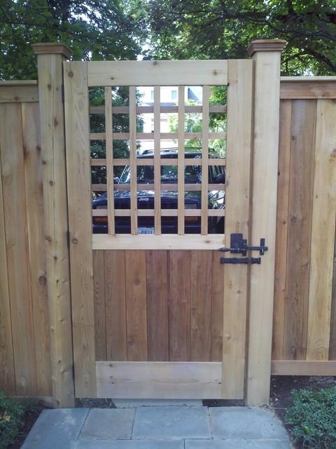 Dark Bronze Lever Handle Gate Latch On Wooden Gate Traditional Landscape