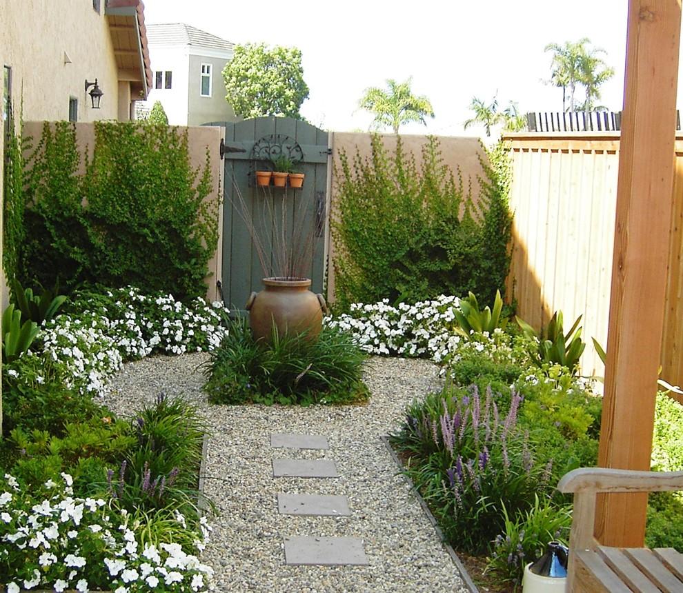 Design ideas for a small mediterranean side yard formal garden in San Diego.