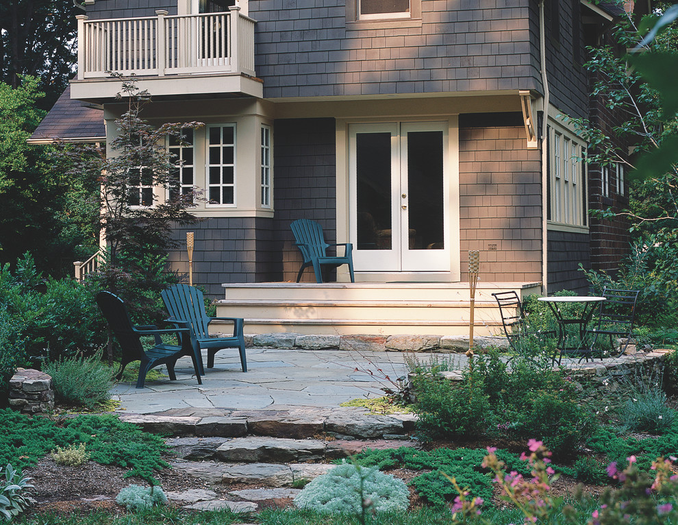This is an example of a traditional backyard stone landscaping in New York.