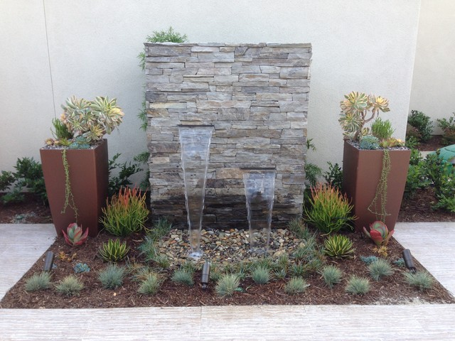 Inspiration for a contemporary water fountain landscape in San Diego.