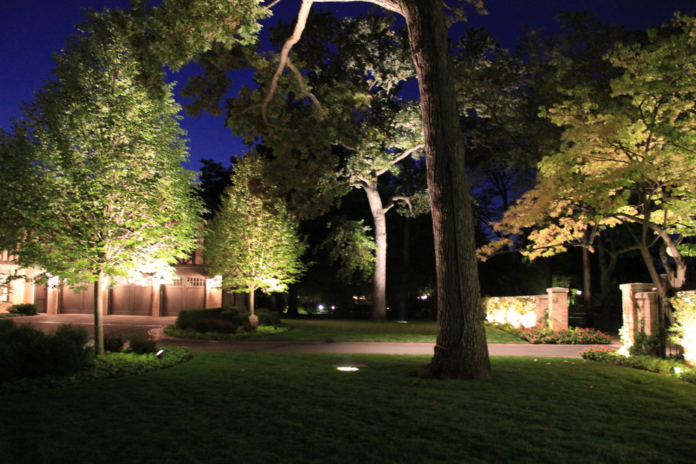 Photo of a large traditional full sun front yard driveway in Chicago for summer.