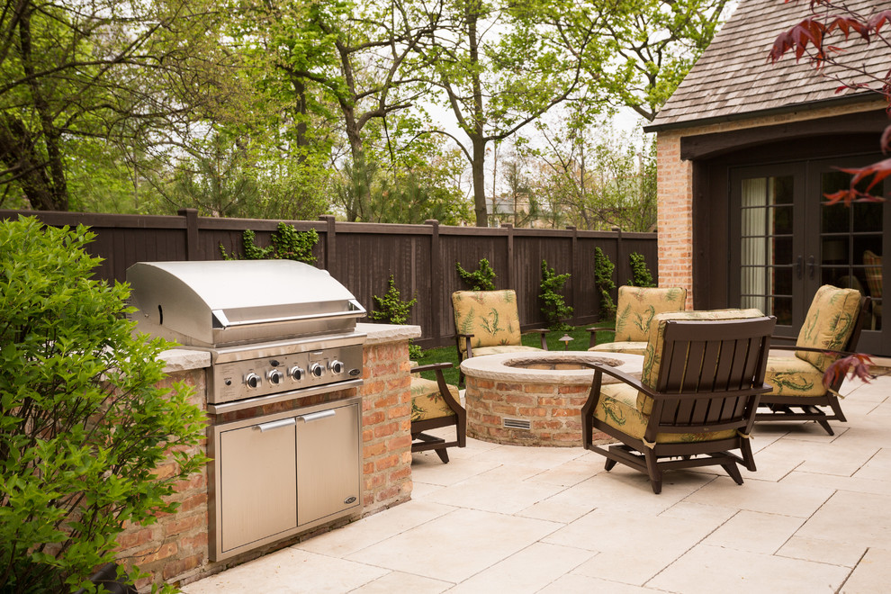 Photo of a large traditional full sun backyard stone landscaping in Chicago with a fire pit for spring.