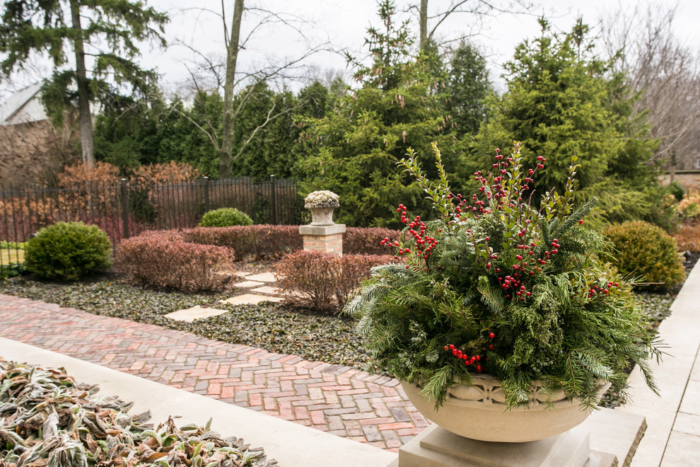 This is an example of a large traditional full sun backyard stone landscaping in Chicago for winter.