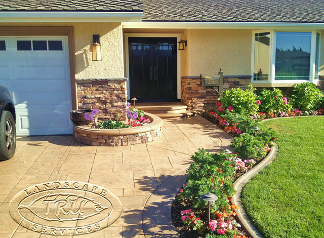 Driveway and stacked stone siding traditional for Landscaping rocks orange county
