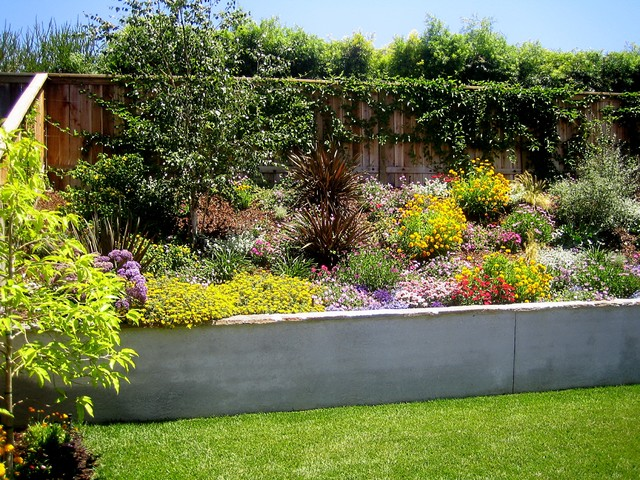 Design ideas for a mediterranean retaining wall landscape in Los Angeles.