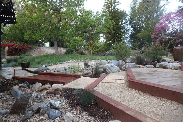 This is an example of a rustic backyard stone landscaping in Los Angeles for spring.