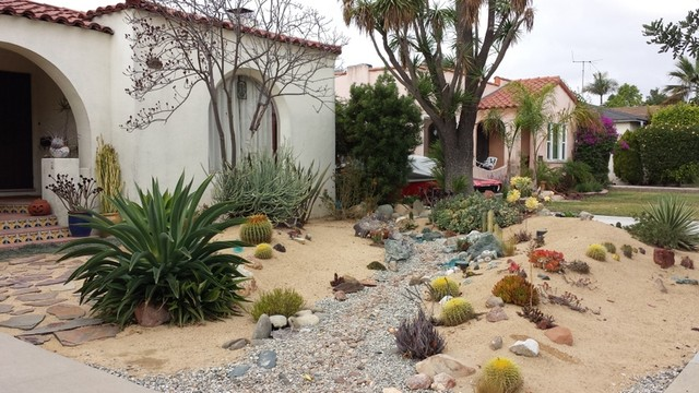 Dry Streambed In A Desert Garden With Spanish Style Home