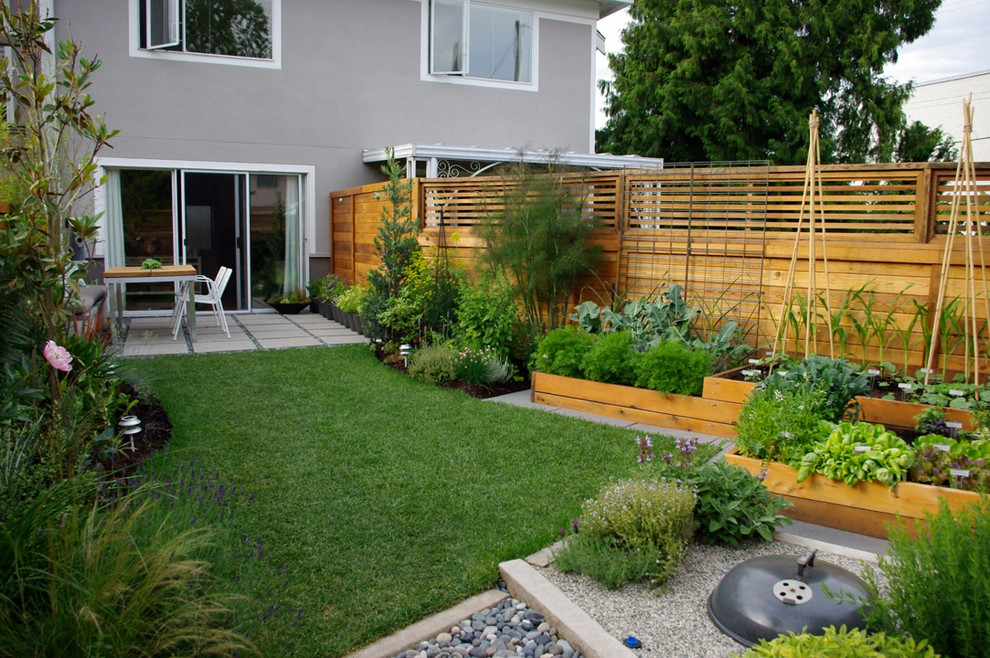 This is an example of a contemporary back garden in Vancouver with a vegetable patch.
