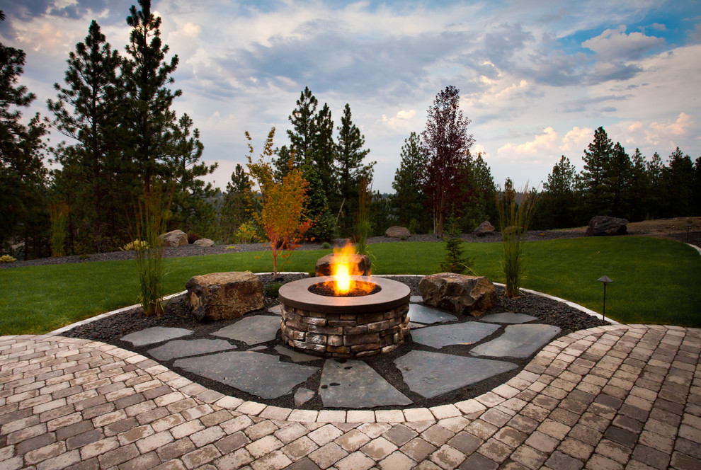 This is an example of a traditional backyard landscaping in Seattle with a fire pit.