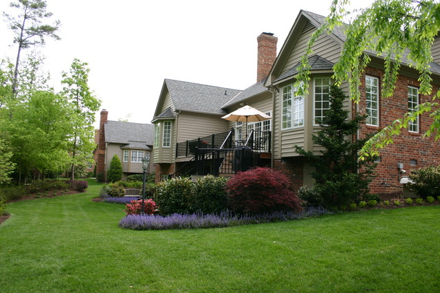 Elegant landscaping for a mid size home traditional for Elegant landscaping