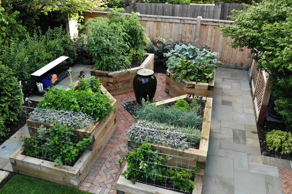 Photo of a small contemporary full sun backyard stone vegetable garden landscape in Chicago for summer.
