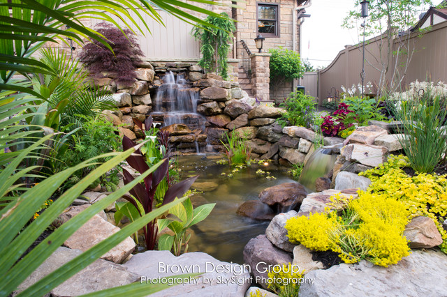 Elegant Tiered Garden traditional-landscape
