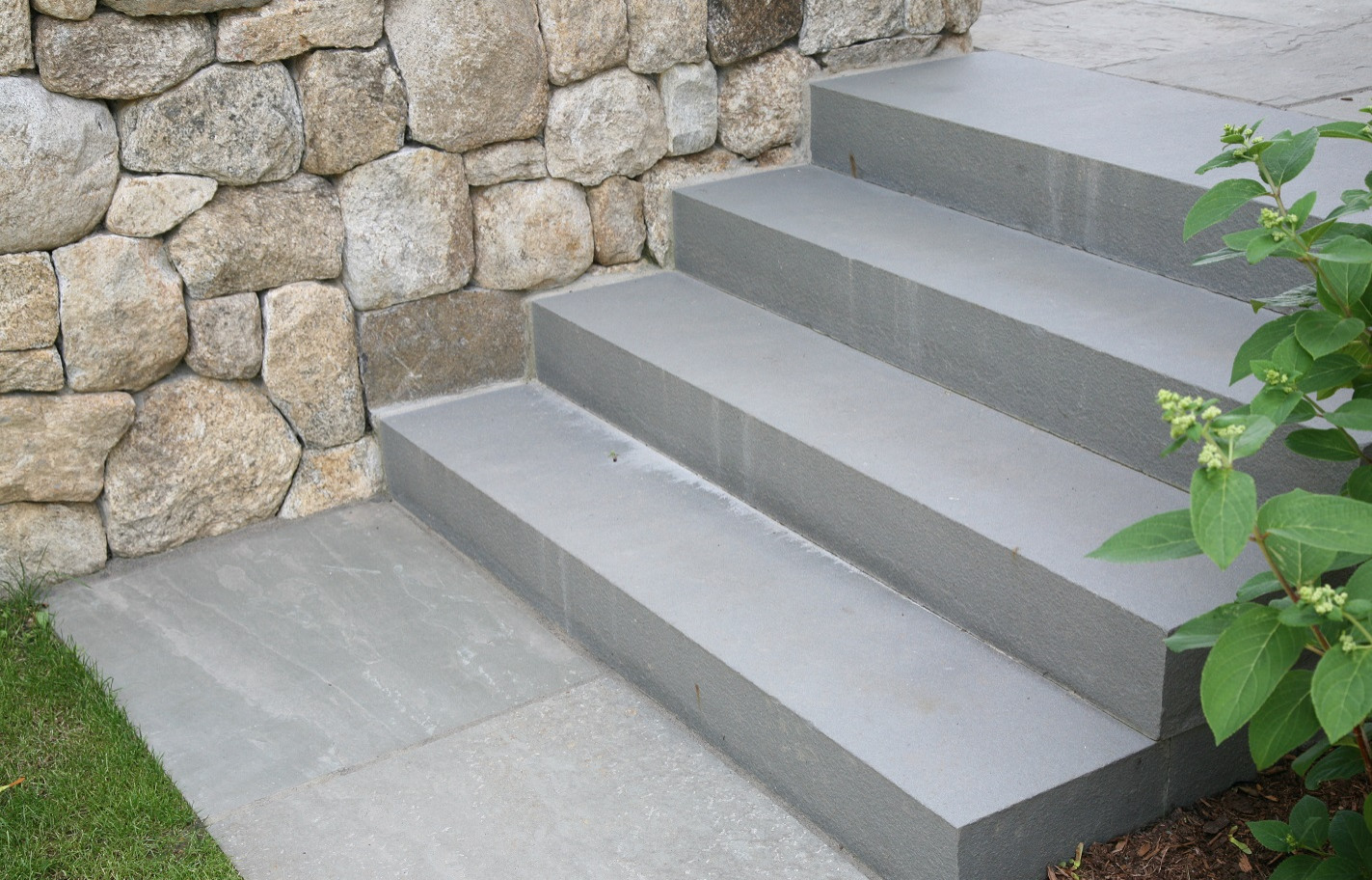 Enduring materials of solid bluestone steps and fieldstone foundation