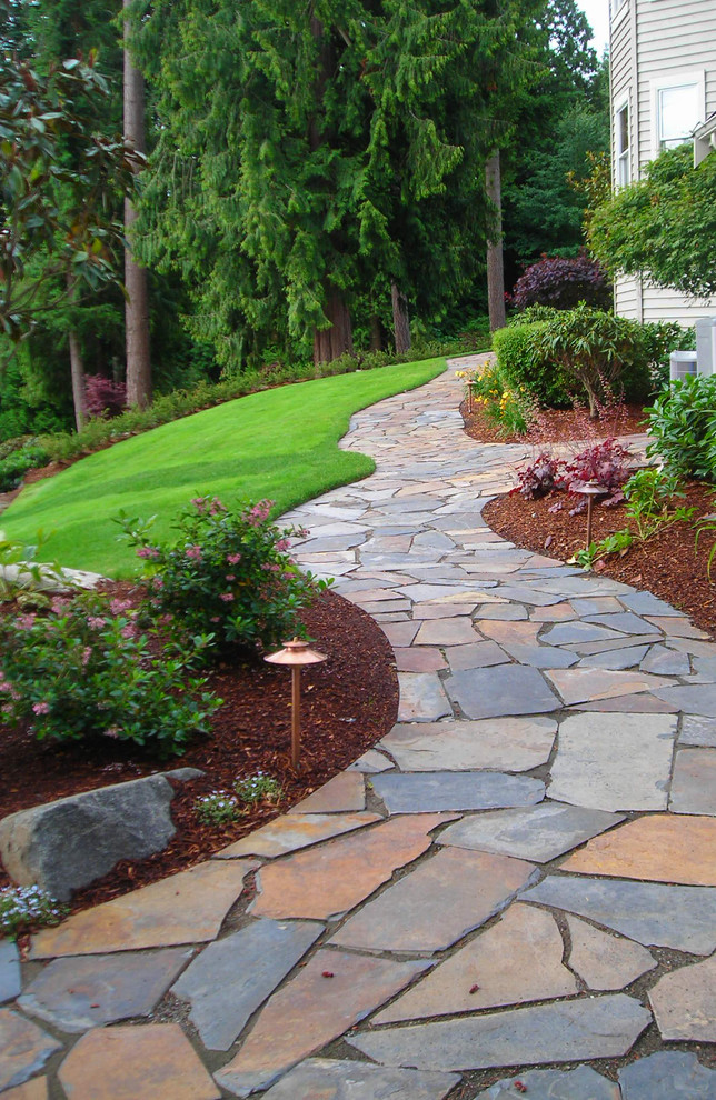 Inspiration for a traditional side yard landscaping in Seattle.