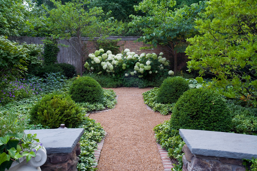 Inspiration for a large traditional shade backyard gravel formal garden in Chicago for summer.