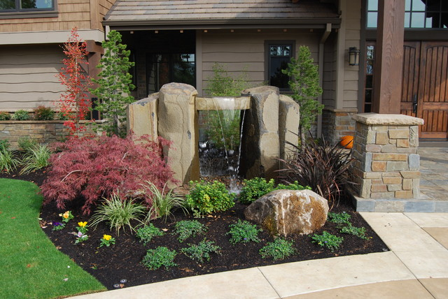 This is an example of a transitional water fountain landscape in Portland.