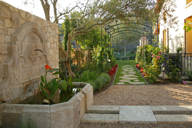 Exterior projects mediterranean style mediterranean for Mediterranean style garden design ideas
