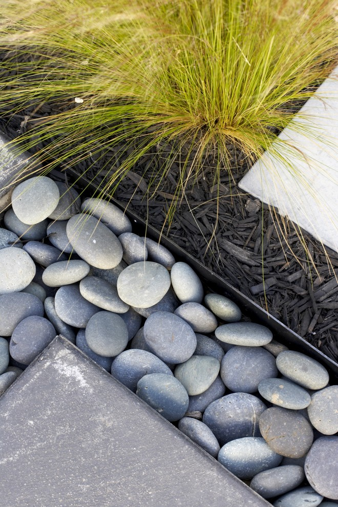 Inspiration for a large contemporary partial sun backyard gravel landscaping in San Luis Obispo.