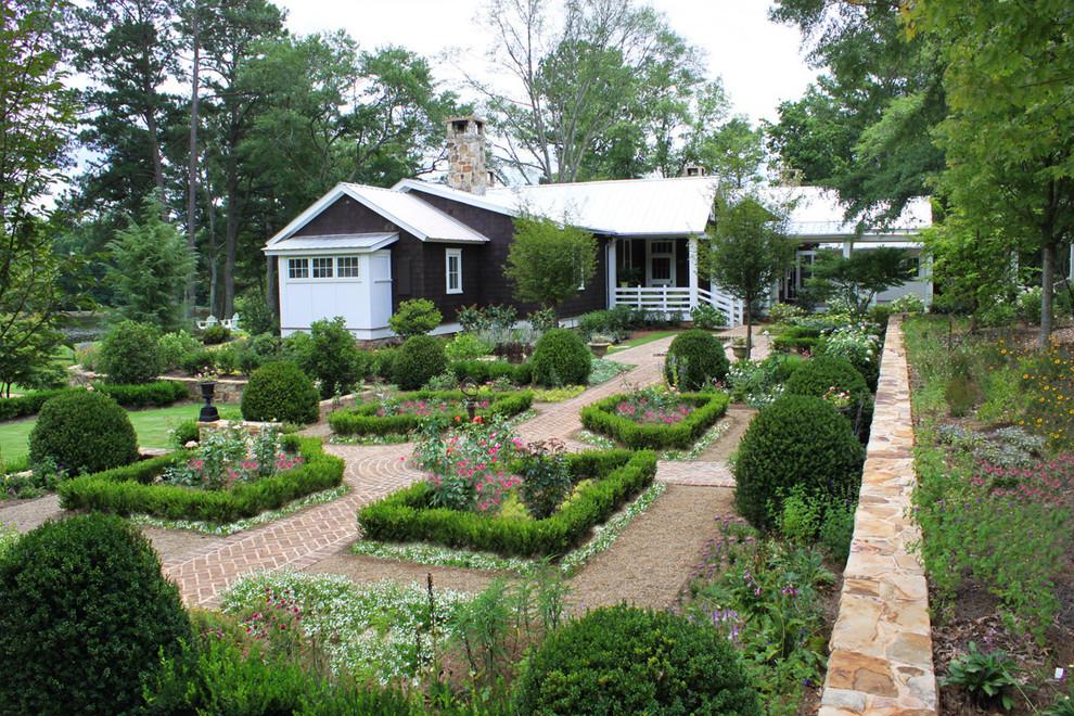 Photo of a large farmhouse backyard brick formal garden in Atlanta.