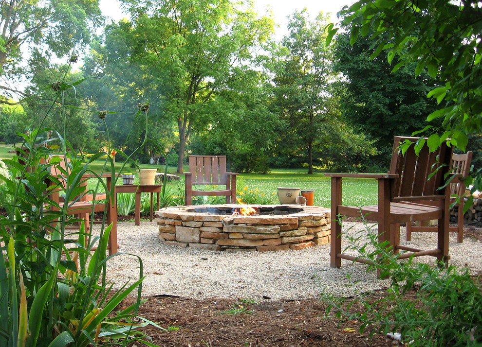 Inspiration for a contemporary landscaping in Milwaukee with a fire pit.