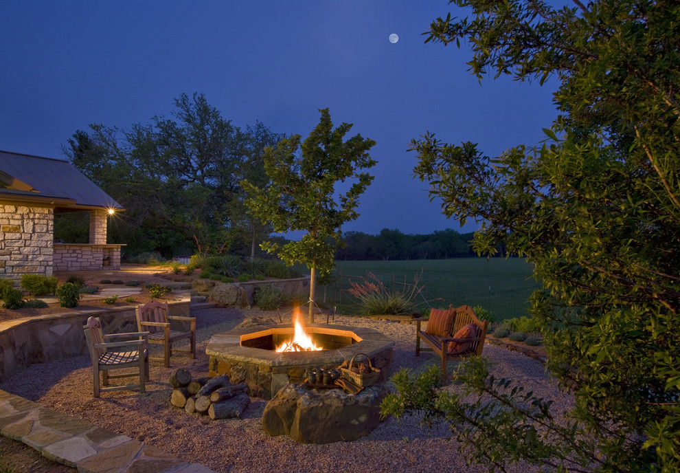 Design ideas for a traditional backyard landscaping in Austin with a fire pit.