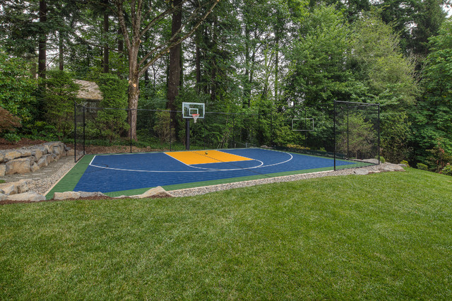 Fire pit sport court oversized paver patio traditional for Backyard sport court