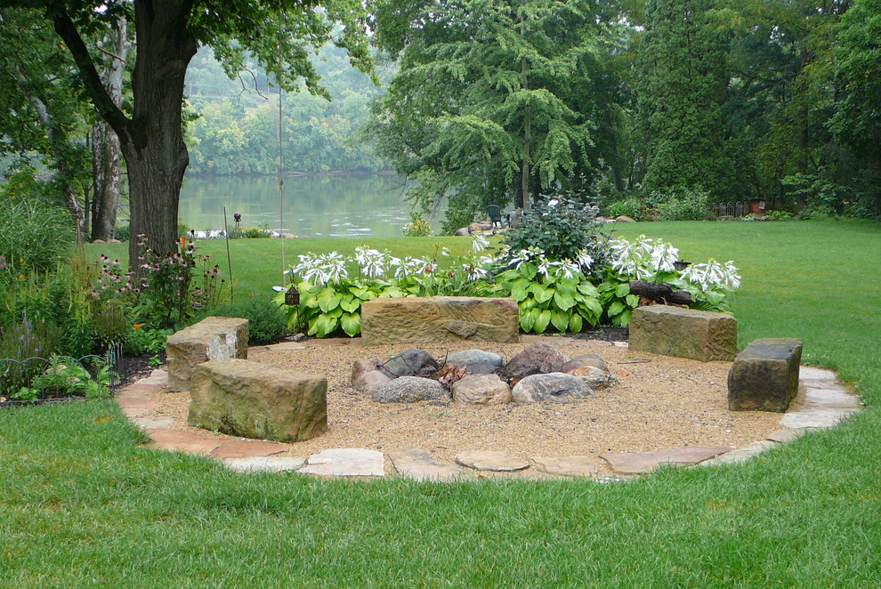 Design ideas for a traditional shade backyard gravel landscaping in Columbus with a fire pit for summer.