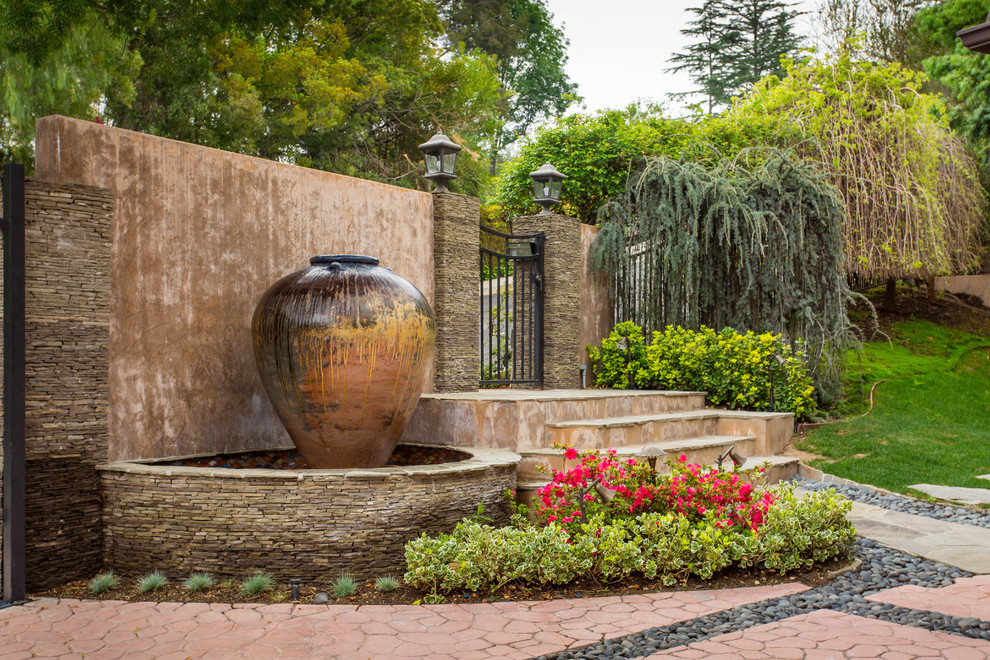 Design ideas for a large mediterranean partial sun front yard concrete paver landscaping in Los Angeles.