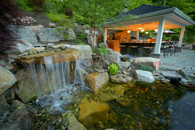 Fish pond with pavilion in the background traditional for Koi pond builders near me