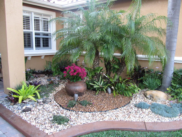 Front yard landscaping tropical ideas home decorating ideas for Small red rocks for landscaping