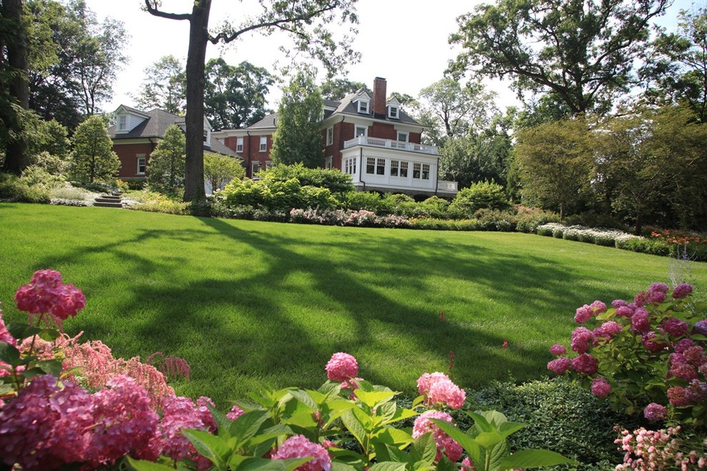 This is an example of a large traditional backyard landscaping in New York.