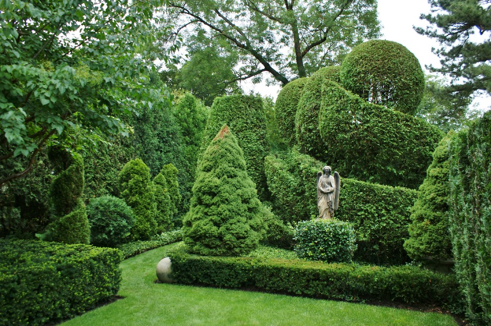 This is an example of a large traditional backyard formal garden in Chicago.